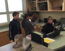 Their first turn at announcements with Ms. Beck.