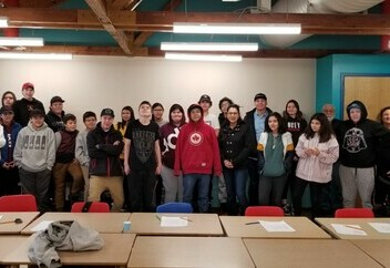 ADCS students along Mikisew Cree First Nation Chief and Council and Ward 9 Trustee Rubi Sakeskanip