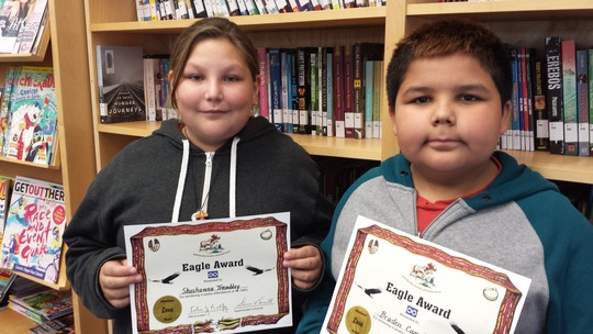 Shashawna Tremblay and Braden Campbell proudly show off their Eagle Certificates for 100% Attendance which they received during the Highest Overall Attendance in the Division Celebration held at the school on September 3/25
