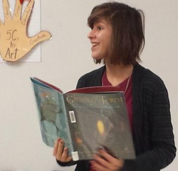 Ms Brenna Smith, Community Outreach Coordinator from  Wood Buffalo Regional Library gets students at the school excited about Words in Motion Poetry Contest
