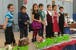 k-3 class rehearsing their play on animals and the nativity
