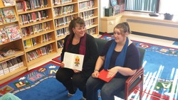 (Sheila Chartrand and her daughter Kallie share memorie with the students that inspired the books.)