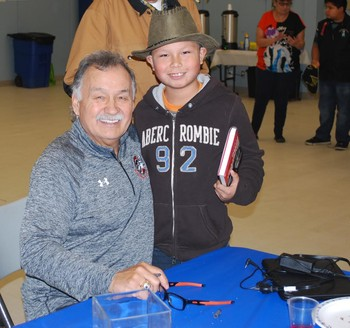 Russell Cardinal Tipler is all smiles as he meets with hockey legend Reggie Leach at the hall.