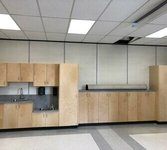 Mrs. Romanowska's new cabinets were installed. They look great!
