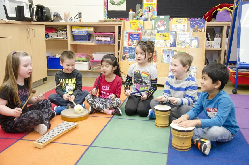 Kindergarten students playing percussion instruments