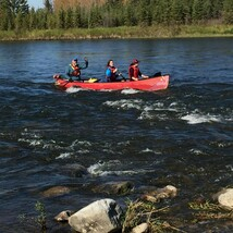 Students row boating at Red Deer River