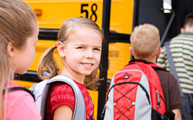 Young students boarding the school bus