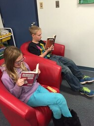 St. Matthew students reading at lounge in Learning Commons