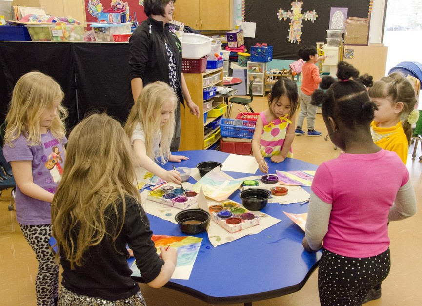 Kindergarten girls building crafts in class