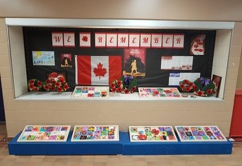 Remembrance Day display in elementary school that features student artworks