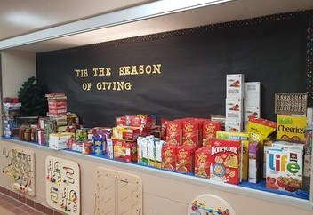 school display case filled with food donations