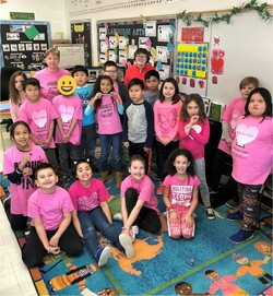 group of students posing in pink shirts for anti-bullying day