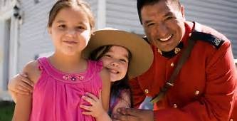 RCMP officer with girls smiling